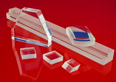 lenses, mirrors prisms red background